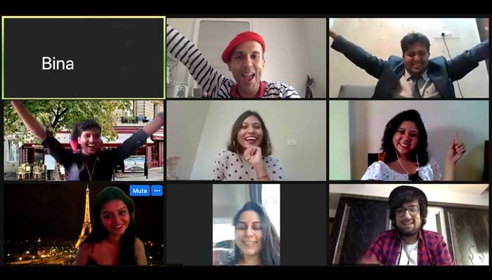 Zoom call in virtual Paris- Woyago Teambuilding - everyone is cheering for a victory