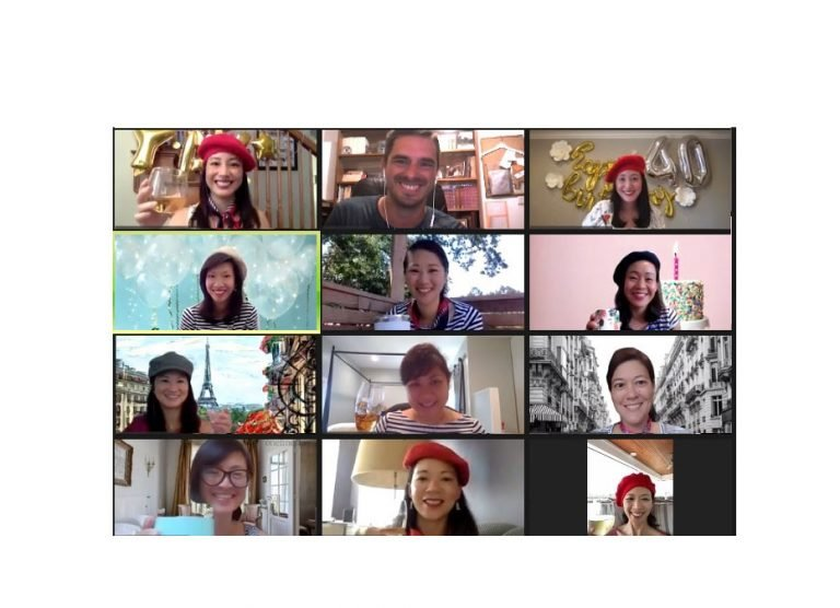 Happy customers on a zoom call wearing red berets and drinking delicious drink