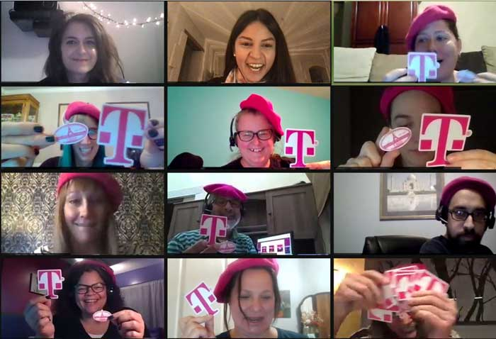 Zoom call in virtual Paris- Woyago Teambuilding - TMobile company, people holding their company logo in front of camera