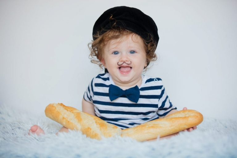 small boy looking like a french man with moustache and baguette