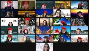 Happy group of company wearing a red berets and smiling on a zoom call