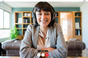 video conferencing tips women with headphones on video conference call