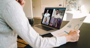 Remote manager holding a virtual budget meeting over video call
