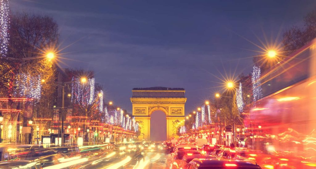 Paris' Champs Elysees street at night with lots of traffic