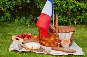 French picnic basket with fruit cheese and wine