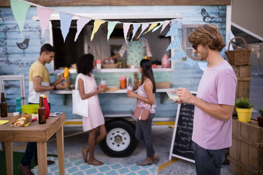 Group of People Eating Food from a food truck