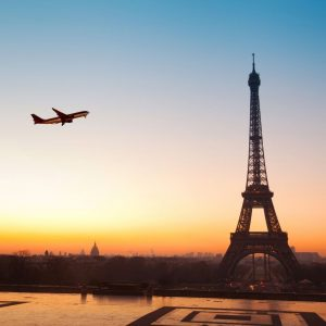 Plane Flying over Paris Near the Eiffel Tower