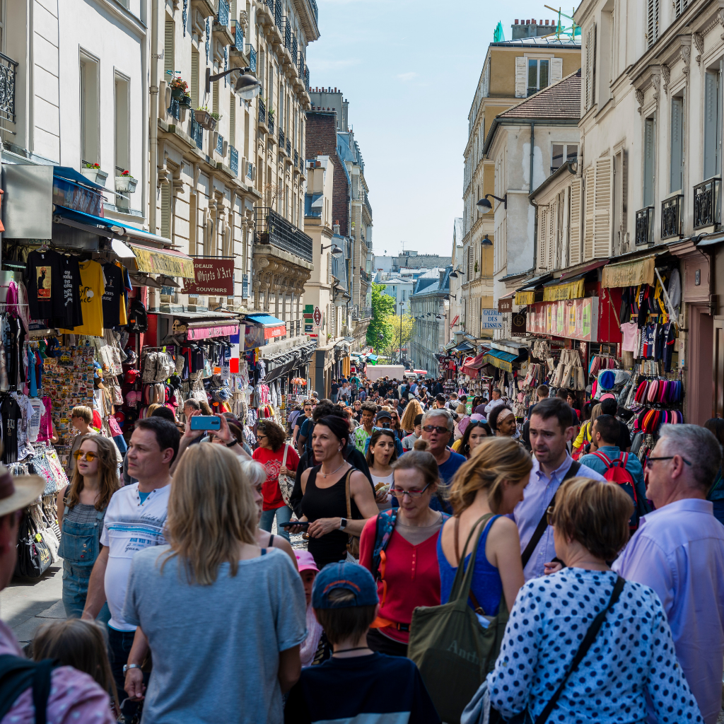 Very busy street in Paris full of people and tourists