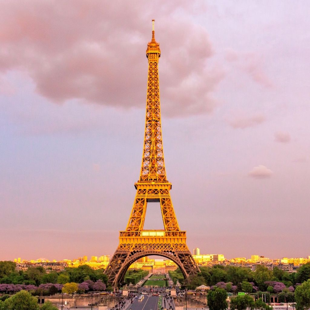 Eiffel Tower against a pink sunset