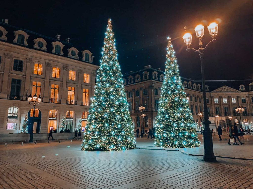 Two large Christmas trees in a square in Paris