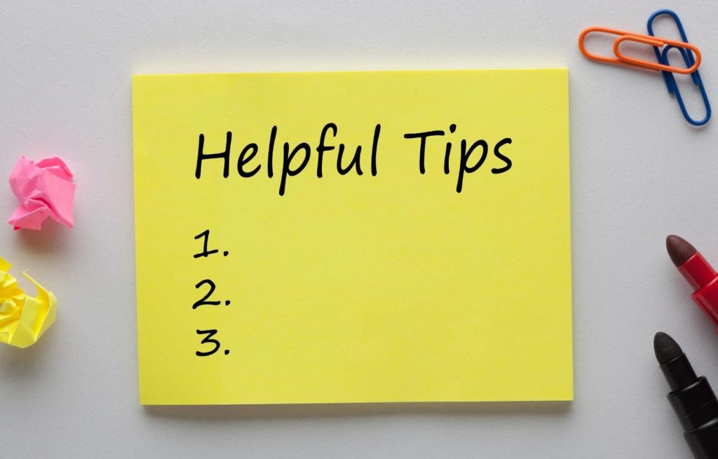 Post it note with the words helpful tips written on it and a list of one through three