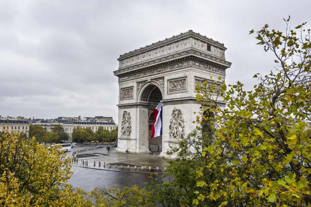 An aerial view of the The Arc de Triomphe on a cloudy rainy day