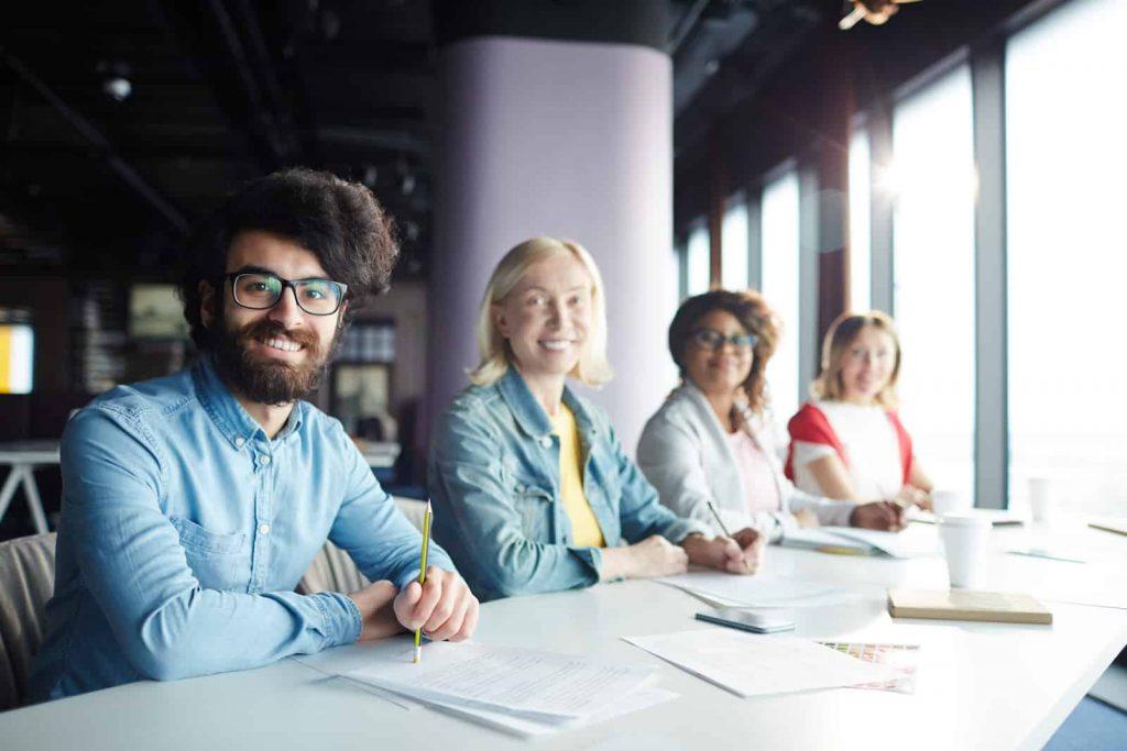 Work employees attending a business meeting