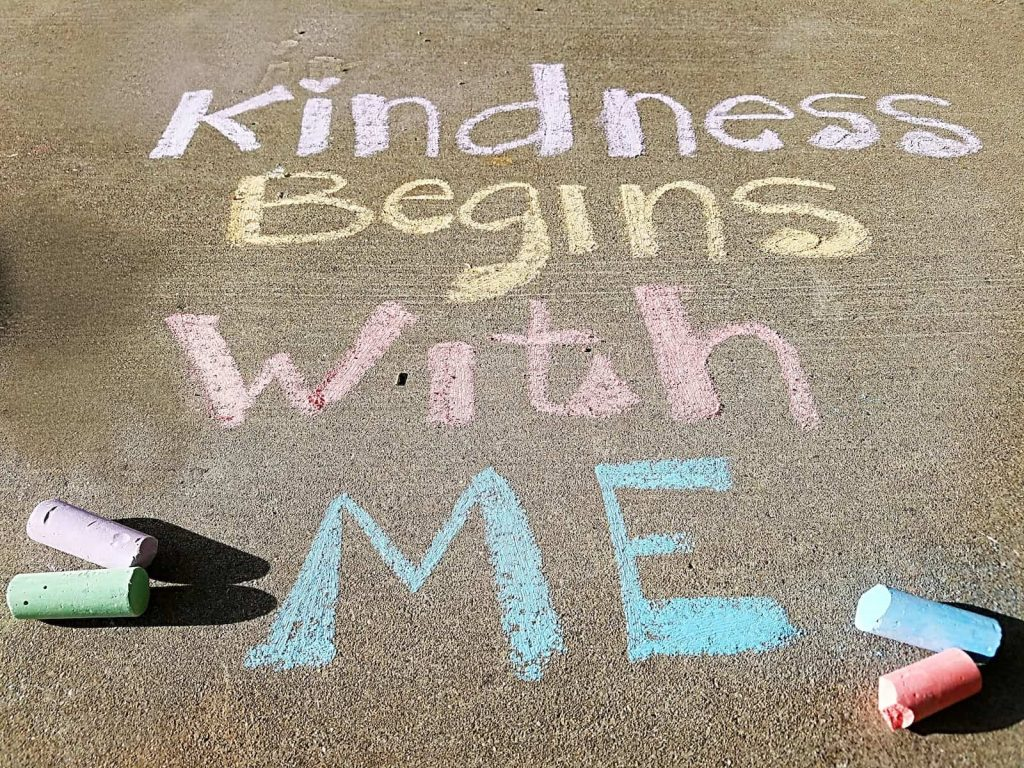 Random acts of kindness ideas for work begins with you message written in chalk