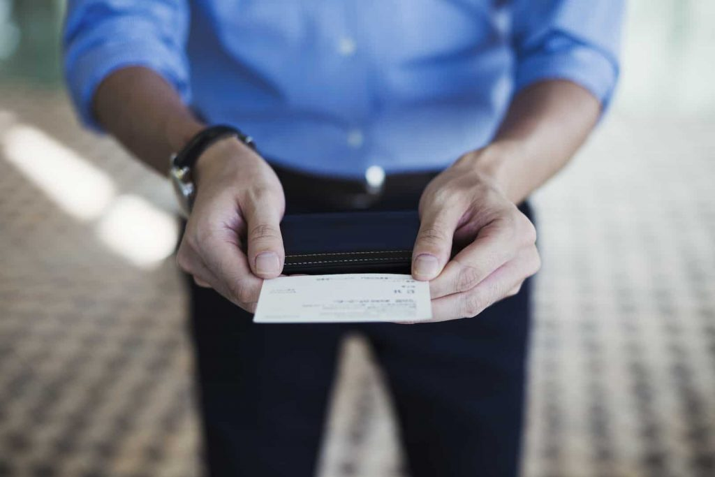 business man holding business card with two hands